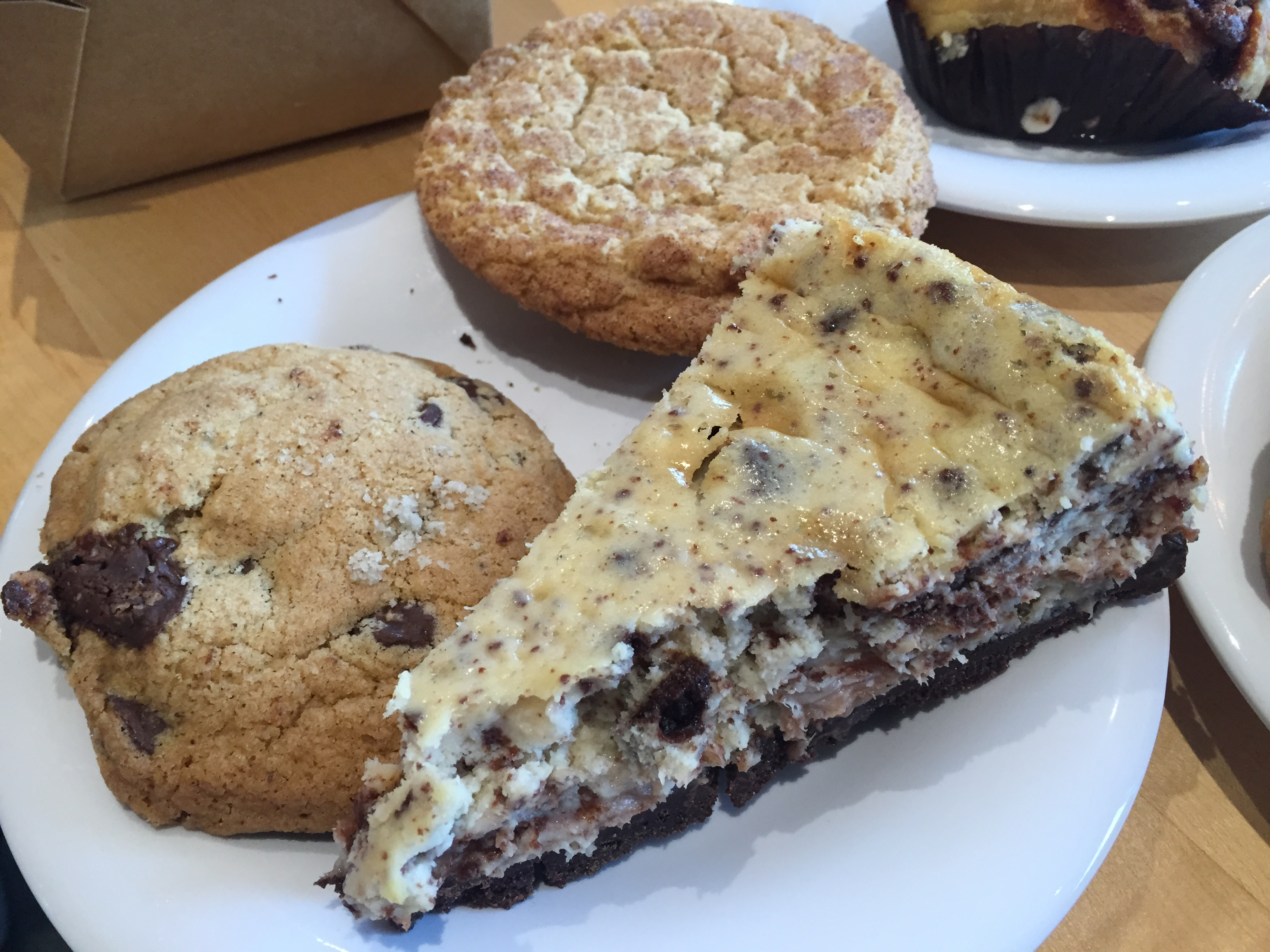 Close-up of cookies and cream cheesecake, chocolate chip cookie, and Snickerdoodle cookie,