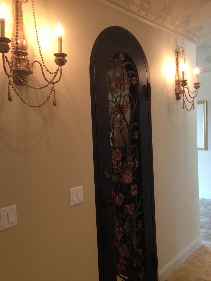 Elaborate door to the wine cellar