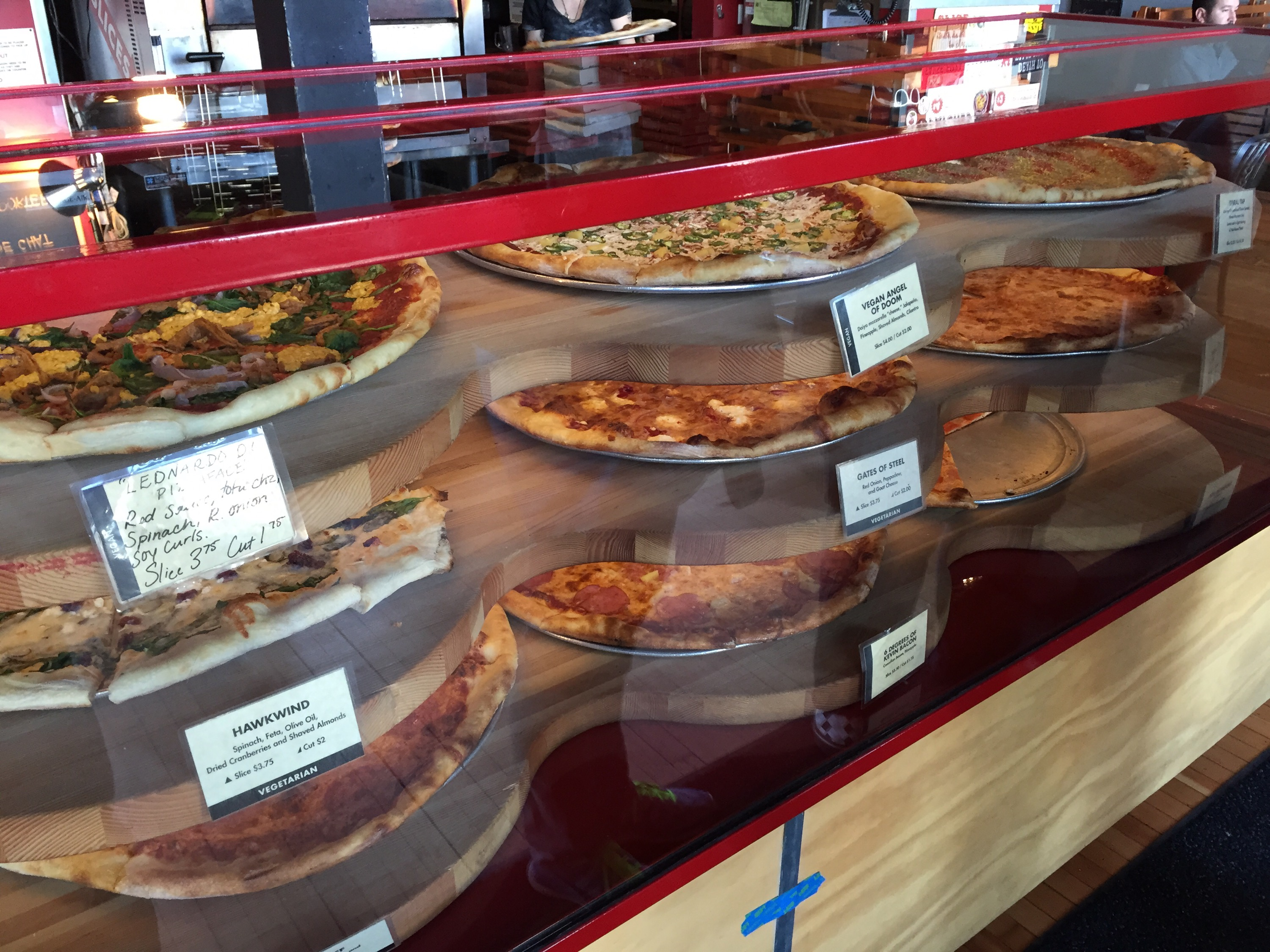 The pizzas available by the slice (a lot of vegetarian and vegan options)