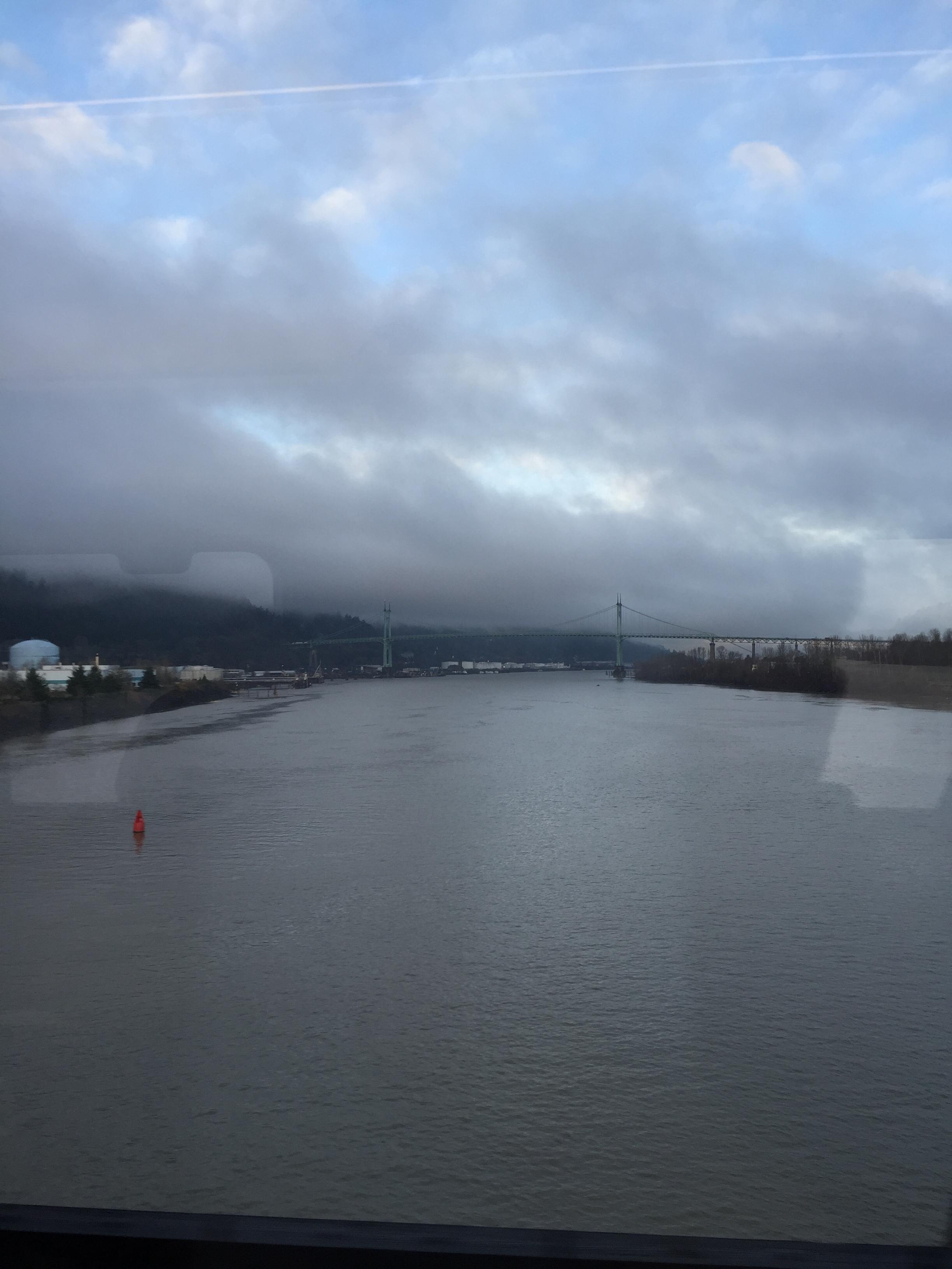 Crossing the train bridge over the Willamette River. The St. John's Bridge in the background.